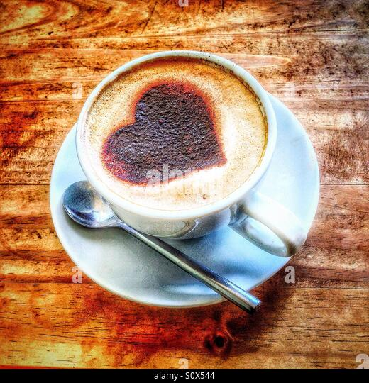 Heart motif in a cup of coffee. - Stock-Bilder