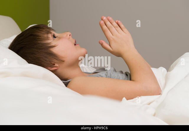 boy praying in bed stock photos boy praying in bed stock. Black Bedroom Furniture Sets. Home Design Ideas