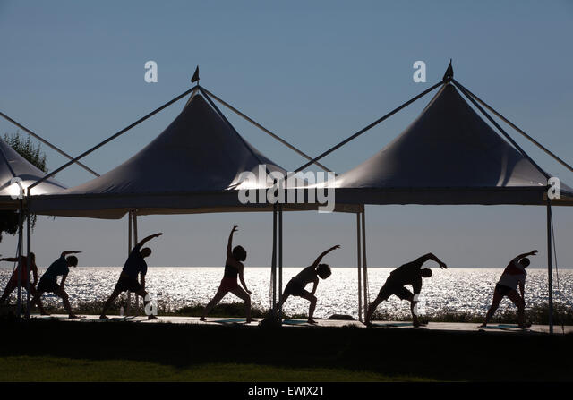 Yoga exercise class in the evening light, Lemnos, Greek islands, Aegean Sea, Greece - Stock-Bilder