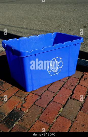 Urban Scene of a Blue Recycling Bin on a Brick Sidewalk Copy Space - Stock Image