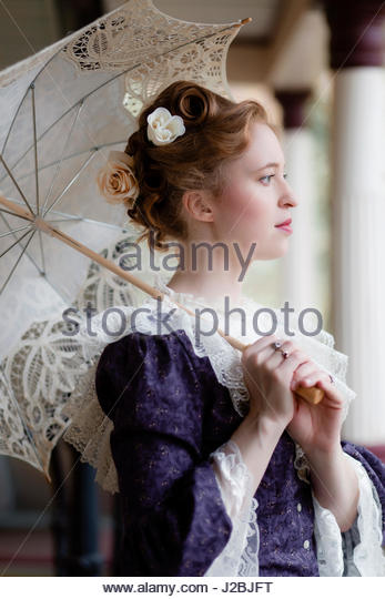 Victorian woman holding a parasol - Stock Image