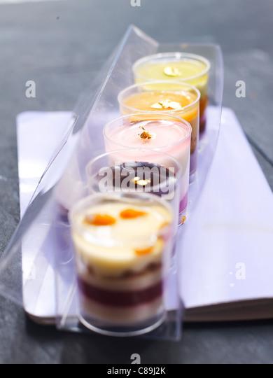 Assorted cream desserts - Stock Image