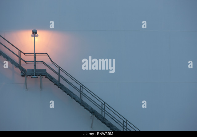 Stairs and light on an oil tank - Stock Image