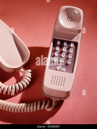 1960s BEIGE TRIM LINE PUSH BUTTON BELL SYSTEM WESTERN ELECTRIC TELEPHONE HAND SET RECEIVER RETRO TELECOMMUNICATIONS - Stock Image