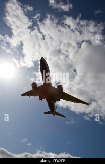 A British Airways Boeing 777 landing at Heathrow airports north runway. - Stock Image