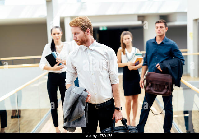 Group of professional business people posing - Stock Image