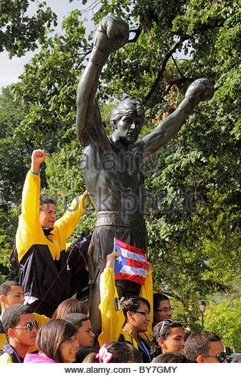 Philadelphia Pennsylvania Philadelphia Museum of Art Rocky movie statue Sylvester Stallone Puerto Rico flag boy - Stock Image