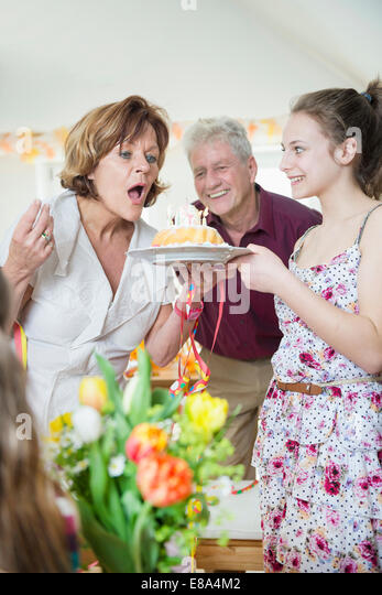 Family celebrating birthday party - Stock Image