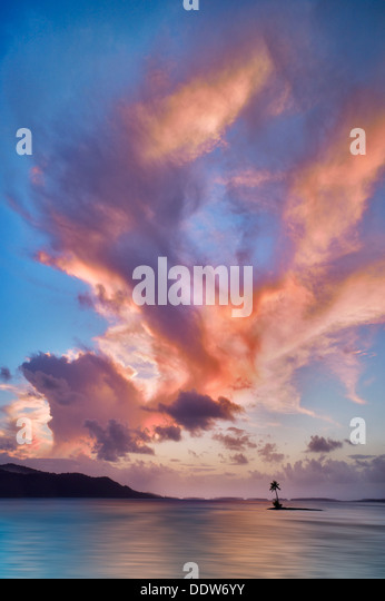 Small island and sunset clouds. Bora Bora. French Polynesia - Stock Image