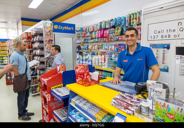 Sydney Australia NSW New South Wales CBD Central Business District EzyMart convenience store inside counter man - Stock Image