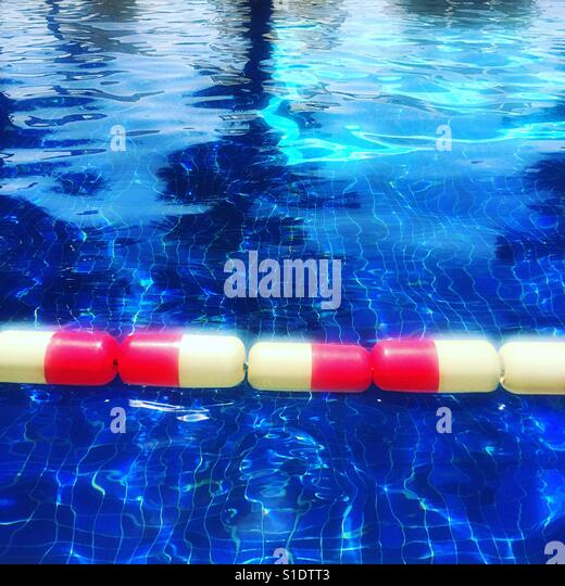 Red and white floats in a swimming pool - Stock-Bilder
