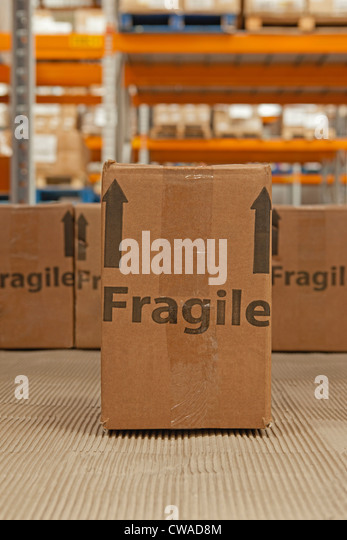 Cardboard box with the word fragile printed on it - Stock Image