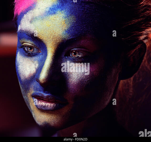 beauty woman with creative make up like Holy celebration in India - Stock Image