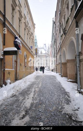 Street scene in winter - heavy snowing urban scene (Czech republic) - Stock Image