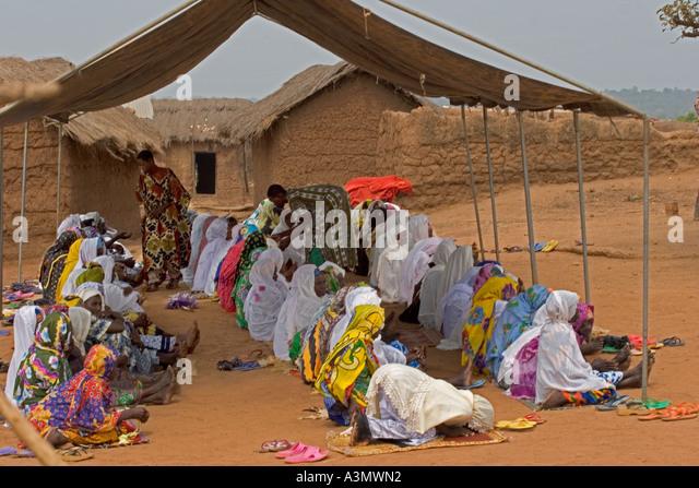 Women worshippers praying at Larabanga Mosque, Ghana - Stock Image