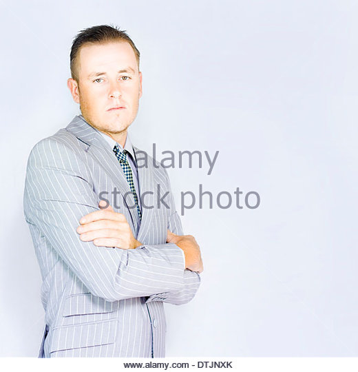 Sideview of a young business man thinking while listening to a colleague in a copyspace conceptual - Stock Image