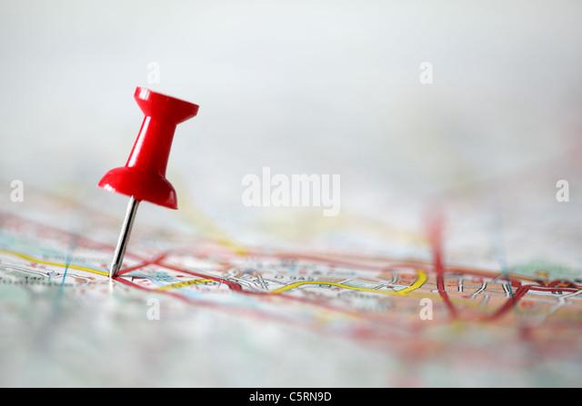 Pushpin on map - Stock Image