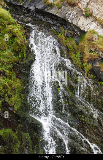 Waterfall on the South West Coast Path, south of Hartland Quay, Devon - Stock Image