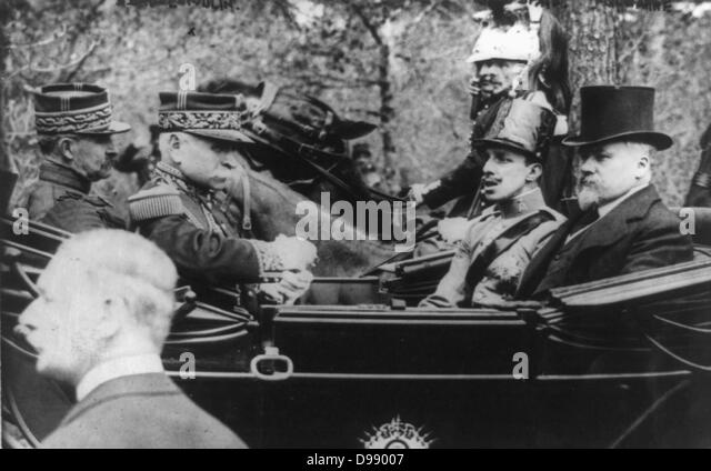 King Alphonso XIII of Spain on a state visit to France shown in a carriage with President Raymond Poincare circa - Stock Image