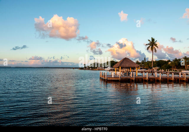 Key Largo Florida Upper Florida Keys waterfront tiki hut sunset Buttonwood Sound Florida Bay - Stock Image