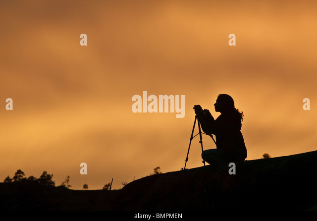 Nature photographer at Reinsfoss in Nissedal, Telemark fylke, Norway. - Stock Image