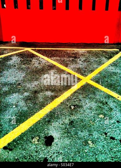 Abstract of yellow lines and red shutter. - Stock Image