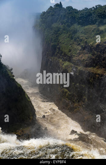 Mist in the Zambezi River Gorge at Victoria Falls in from Livingstone Point in Mosi-Oa-Tunya National Park, Zimbabwe - Stock Image
