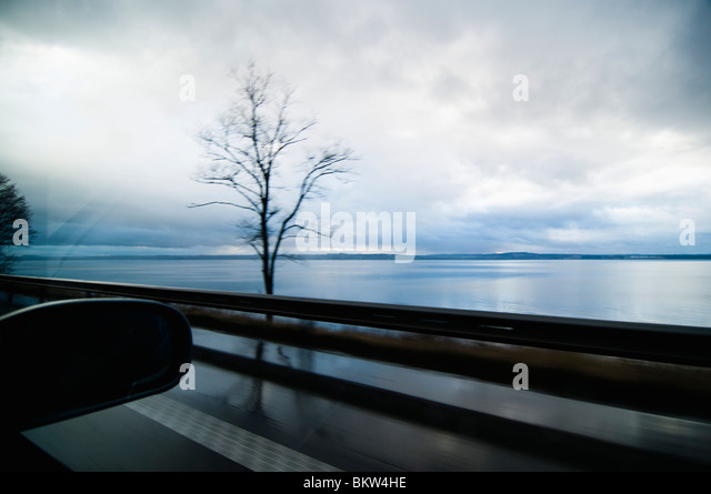 View over lake from car window - Stock Image
