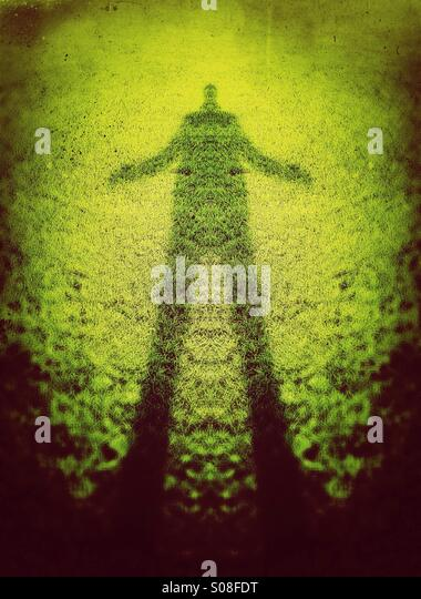 Giant green man - tall shadow of a man - Stock Image