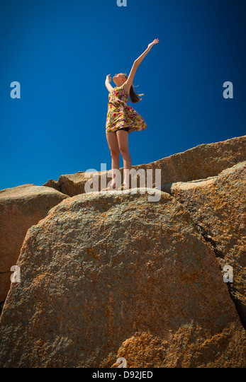 Girl at top of the Enchanted Rock in Texas - Stock Image