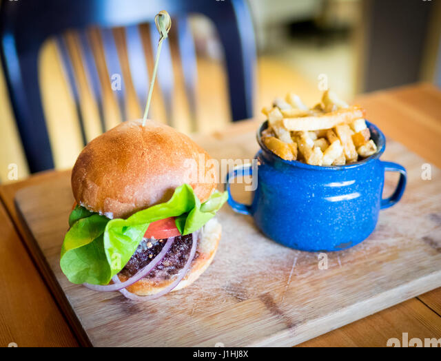 A classic burger and fries (hamburger and French fries) from Ayden Kitchen and Bar in Saskatoon, Saskatchewan, Canada. - Stock Image