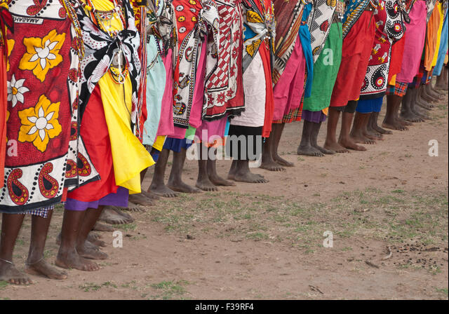 a-line-of-barefoot-masai-women-wearing-t