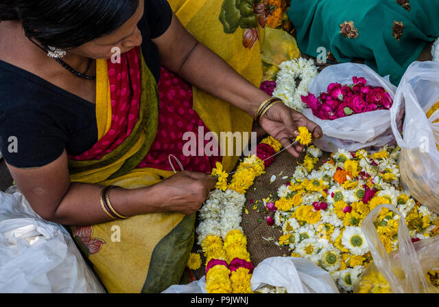 indian-woman-making-traditional-flower-g