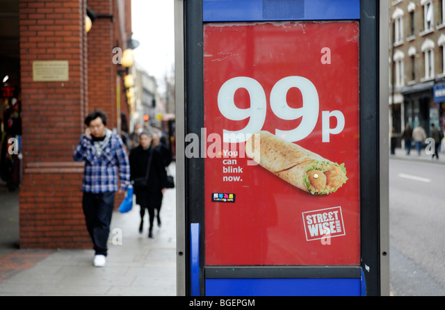Advertising for 99p cheap meal deal by high street take-away. London. UK 2009 - Stock Image