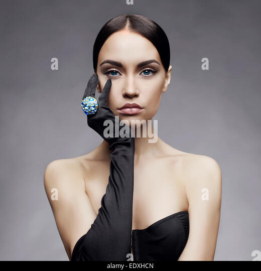 Fashion photo of beautiful lady in gloves with diamond ring - Stock Image