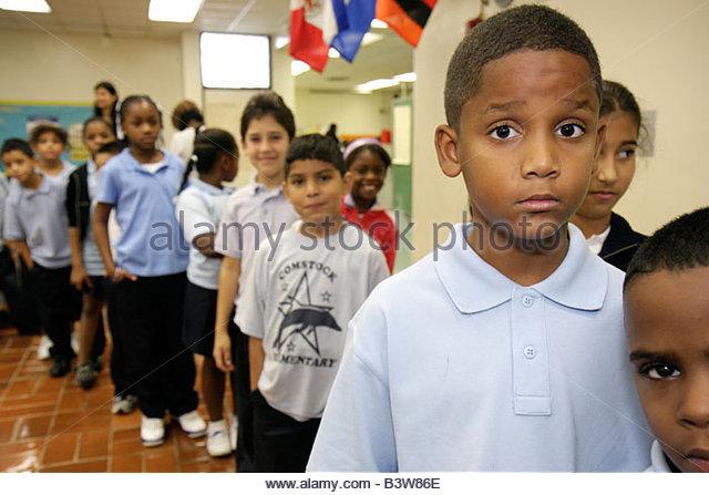 Miami Florida Comstock Elementary School Welcome Back Back Pack Giveaway Hispanic Black boy boys student child children - Stock Image