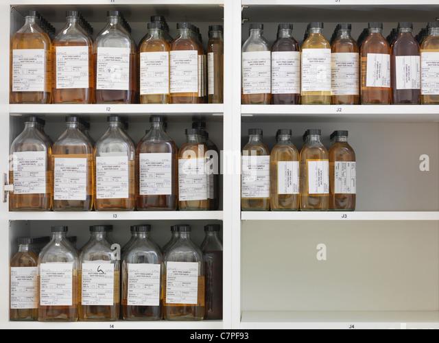 Sample bottles on shelves - Stock Image