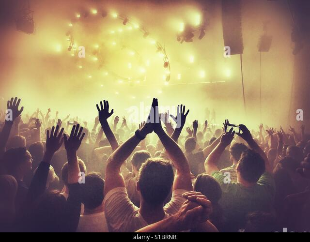 A crowd enjoying a music gig - Stock Image