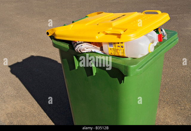 Waste Management / A Waste Recycle bin stands ready for collection. - Stock Image