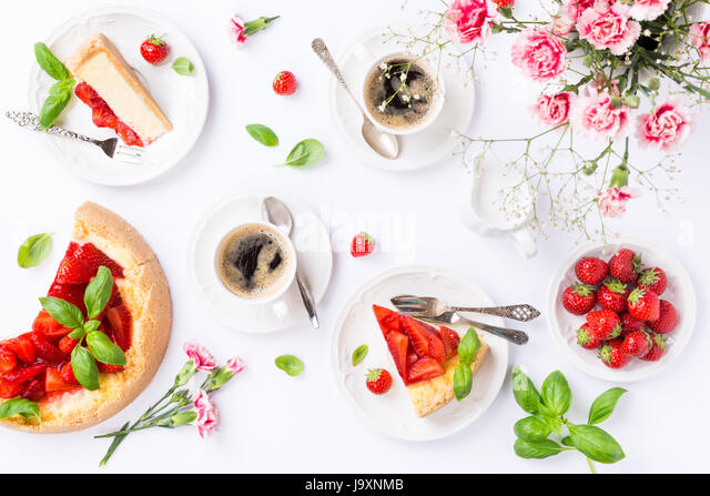 Flatlay with strawberry cheesecake - Stock Image