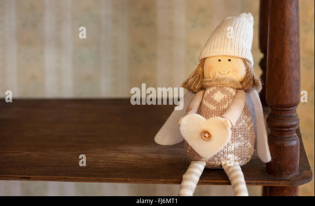 nostalgic decoration angel empty book shelf still life vintage style - Stock Image