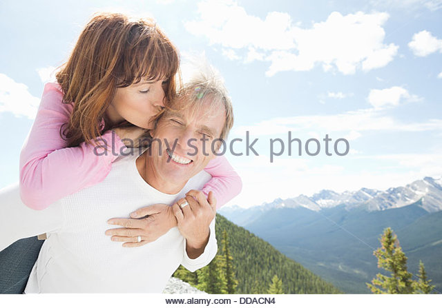 Affectionate couple having fun outdoors - Stock Image