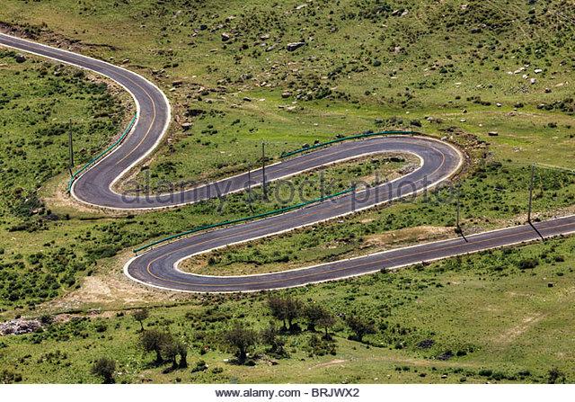 Winding road in the Kyi Chu Valley. - Stock-Bilder