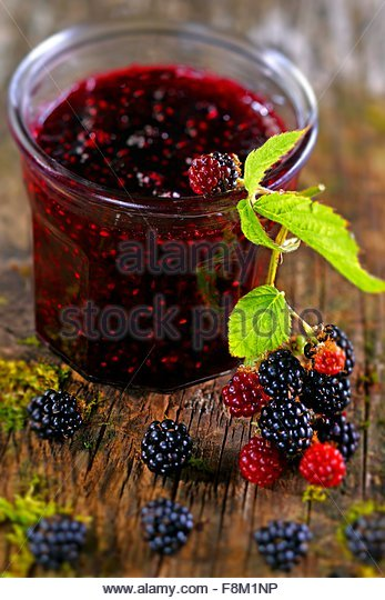 A jar of blackberry jam - Stock Image