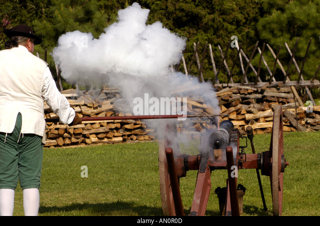 colonial williamsburg virginia cannon firing demonstration lighting the fuse - Stock Image