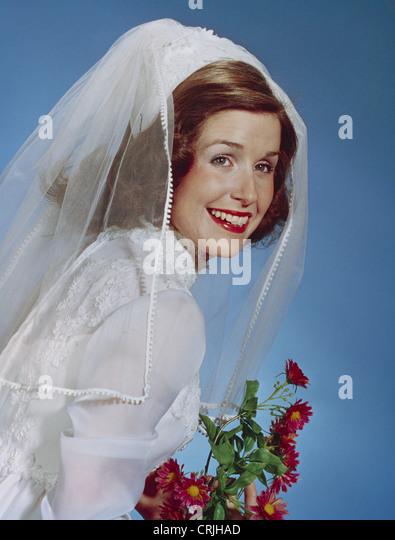 Vintage portrait of bride smiling - Stock Image