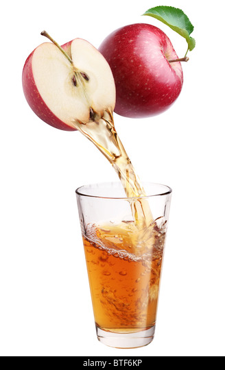 Fresh apple juice flowing from apple piece into the glass. - Stock-Bilder