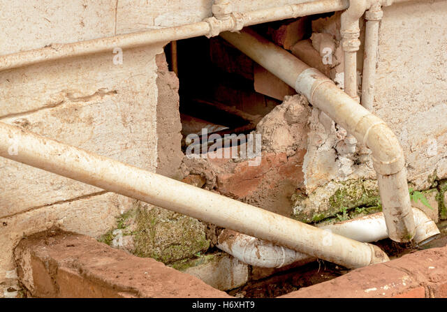 Cement drain stock photos cement drain stock images alamy for Water wall plumbing
