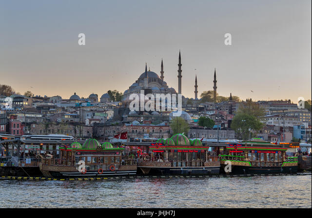 Istanbul, Turkey - April 25, 2017: Traditional fast food bobbing boats serving fish sandwiches at Eminonu district - Stock Image