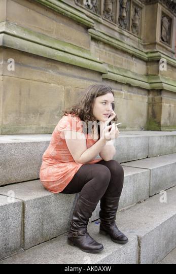 Manchester England UK Albert Square female teen smoking cigarette - Stock Image